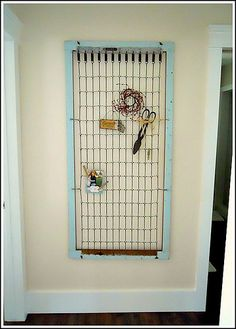 something neat to do with crib wire thingy...I think you could even hook some storage containers on it...hmmm