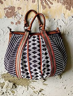 i love to rock mixed pattern bags like this with a monochromatic outfit :: Beaded Ethnic Tribal Style Tote Bag