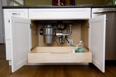 pull-out drawer under the sink.