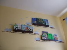 Train Book Shelf Idea for a Boys Room, This mom uses train wall decals to create a train themed book shelf on the wall of her little boys room., A close-up of the bookshelves.  , Boys Rooms Design