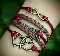 Leather & red bracelets, cute Eiffel Tower #Paris #jewelry #bracelets would be better in black, red and silver