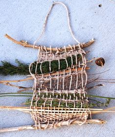 weaving with yarn and branches, earth loom