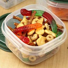 Gone Fishin' Cheesy Snack Mix - Fish-shaped crackers, pretzels and cereal are combined with sweet gummi fish and worms for a fun snack mix.
