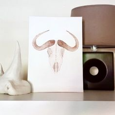 A monochromatic painting of a buffalo skull in shades of brown. It has a rustic vibe and its neutral color will fit into any room. If you are looking to add a bit of a character in your space this painting is definitely what you are looking for.  Flat canvas panel of 18.2 x 25.7 (cm)  Watercolor paint Monochromatic Paintings, Buffalo Skull, Watercolour Painting, Neutral Colors, Place Card Holders, Shades, Rustic, Flat, Canvas