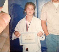 MMA fighter Ronda Rousey began winning championships at a young age! Ronda Rousy, Judo Training, Ronda Jean Rousey, Rowdy Ronda, Ufc Women, Wwe Wallpaper, Ufc Fighters, Brazilian Jiu Jitsu, Mixed Martial Arts