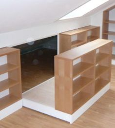 Bookshelf slides out to reveal more storage tucked into the slanted roof area. Dachausbau als Wohnraum ?fele Functionality World Attic Bedroom Designs, Attic Bedrooms, Attic Design, Attic Bedroom Storage, Loft Conversion Bedroom, Loft Storage, Loft Room, Attic Remodel, Attic Spaces