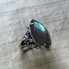 Stargazer Lily Ring- Labradorite and Sterling Silver by LuraJewelry on Etsy https://www.etsy.com/listing/288567393/stargazer-lily-ring-labradorite-and