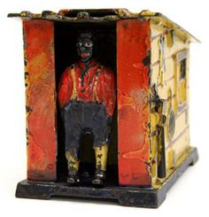 Circa 1885: This end of the day Cabin mechanical bank contains the partial fingerprint of its original decorator. This literal human touch adds a fine folky feel to this desirable piece of early black Americana.