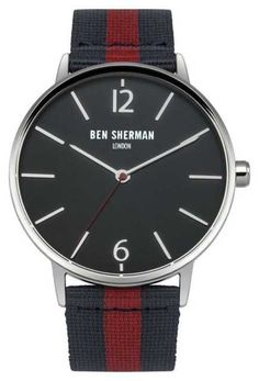 This new Ben Sherman watch WB044UA features a black dial watch is a smart lifestyle investment that has classical elements with contemporary updates. Key features include a stainless steel case, silver hands and a round dial,and is fasten with a black & red webbing strap with leather trim
