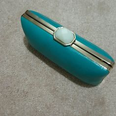 New Trina Turk for Banana Republic Clutch Gorgeous turquoise box clutch in faux leather with goldtone and faux mother of pearl clasp. Chain included. Trina Turk Bags Clutches & Wristlets