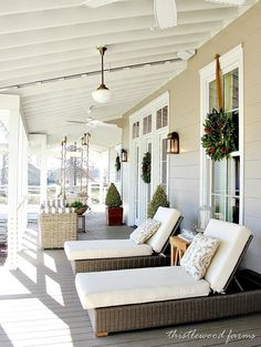 Southern-living-idea-house-back-porch - love the wreaths hanging from the window... - http://centophobe.com/southern-living-idea-house-back-porch-love-the-wreaths-hanging-from-the-window/ -
