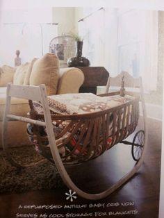 antique baby crib as blanket storage