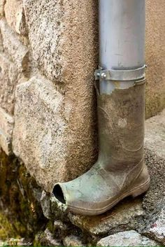 This Ivy House - rainboot downspout; use an old kids boot for an adorable look