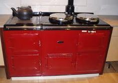 I'd put an Aga in my house in a heartbeat...if I didn't live in the South.  These beauties are meant to heat houses in the UK and cook your meals.  In fact, I've seen folded laundry stack in the burner covers assisting with the drying.  Still, I want one!