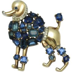 Very sought after 1950  Crown Trifari Alfred Philippe shades of blue crystal rhinestone poodle figural brooch or pin.  This delightful poodle is from
