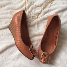 Sally wedge ️️TRADES. Sally wedge 2 peep toe snake print leather, stacked wedge heel. Gold TB logo. Salmon color. Heels show minor signs of wear. Padded insole for comfort. Pre'd but in good condition. Tory Burch Shoes Wedges