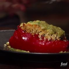 Guy Fieri stuffs his peppers with ground turkey, red quinoa and kale before topping them with a panko-Parmesan mixture and a drizzle of Roasted Tomatillo Avocado Sauce. These just may be the most satisfying stuffed peppers around.