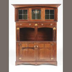 English, circa 1905 An Art Nouveau mahogany and marquetry side cabinet