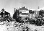 """United Airlines Flight 553 crashed into a row of bungalows on West 70th Place, in Chicago, while approaching Midway Airport on Dec. 8, 1972, killing 43 of the 61 persons aboard, and two in a home. The plane left Washington, D.C., for Omaha and was about to make a planned stop in Chicago when the pilot was instructed by the control tower to execute a """"missed approach"""" pattern. As he went around for another landing attempt, the plane struck tree branches and then some bungalows before plowing…"""
