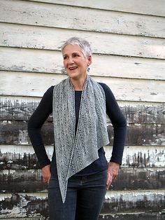 Motifs lifted from the Art Deco period are combined to create a lively texture across this asymmetric shawl in two sizes (petite/tall), meant to be worked in a shimmery yarn blend. While the visual effect is complex, the patterns are simple to work, relying on the tension of cable crosses to pull the ribbing back and forth; light and dark areas are the result of shifting fabric density. This design is worked in one piece from beginning to end and is easily resized.