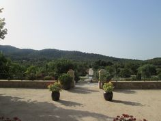 View of the Castell Son Claret Estate from the hotel front entrance Front Entrances, Luxury, Plants, Plant, Front Doors, Planting, Planets