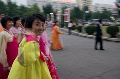 A Korean woman waves after the mass dance, September 2011.
