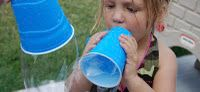 Make Giant bubbles! Poke a hole in the bottom of a paper cup, or cut off the bottom of a water bottle. Dip. Blow.