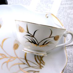Altered Vintage Teacup and saucer golden floral set by geekdetails, $75.00