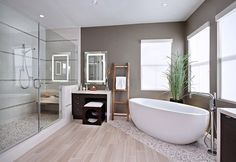 wood look ceramic floor tiles but up to pebble mosaic tiles to delineate different zones in wet room/ bathroom