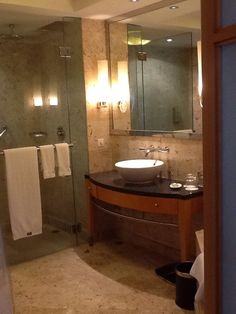 For master bath (from Dhaka hotel). Like the wood, tile color, and glass look