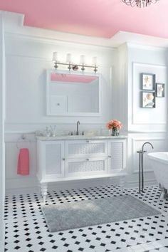 I love this idea- the whole bathroom is white, except for the pink ceiling. beneathmyheart.com