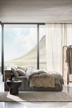 Washed linen duvet cover set by H&M Home. Beige-toned bedroom with a stunning view.  #beige #beigetoned #bedroominspo #homedecor