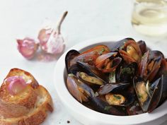 Sauvignon Blanc-Steamed Mussels with Garlic Toasts | Food & Wine goes way beyond mere eating and drinking. We're on a mission to find the most exciting places, new experiences, emerging trends and sensations.