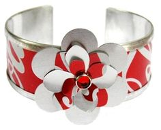 Iconic Coca-Cola turned retro in this handmade cuff with large flower