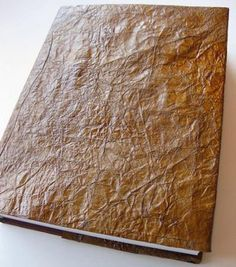 How to Create a Faux Leather Book Cover - using a paper bag - via Design Sponge Leather Book Covers, Leather Books, Leather Notebook, Leather Journal, Paper Bag Crafts, Book Crafts, Cool Ideas, Do It Yourself Baby, Creation Deco