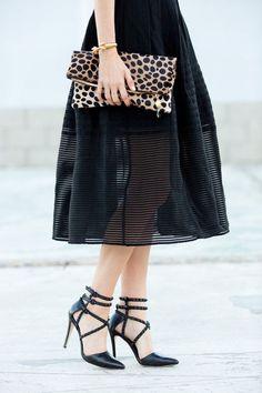 black skirt, leopard clutch
