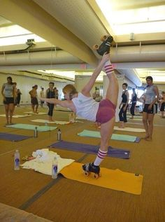Roller derby yoga badass. check out that other girls face!