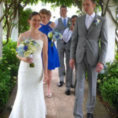 The bride and groom walk though the vines as the marry on the Ground of Bedell on the Northfork of Long Island