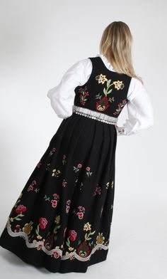 "Black ""Grafferbunad"" with embroidered waist and skirt from Lom, Gudbrandsdalen, Oppland, Norway (I don't think the belt is originally a part of this bunad. The bunad also have a hat, but the model doesn't wear it)"