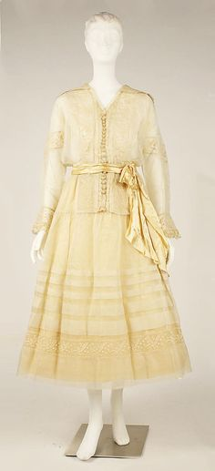 Dress ca. 1910. The Met.  Looks more like the latter part of the 1910s to me, from the wider, shorter skirt and blousier tunic.
