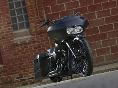 This 2010 custom Harley-Davidson Road Glide motorcycle looks villainous in flat black paint and owns the road with her power and reflexes. #harleydavidsonbaggerpaint #harleydavidsonroadglideblack