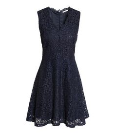 Dark blue. Sleeveless dress in openwork lace with a V-neck. Concealed zip at back, seam at waist, and flared skirt. Jersey lining.