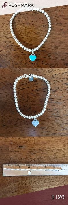 BEAUTIFUL Tiffany & Co. Bracelet Lightly used, worn a few times. Beautiful sterling silver & small Return to Tiffany & Co. heart. Reversible side heart with Tiffany blue color. Minimal scratches; clasp works great! Tiffany & Co. Jewelry Bracelets