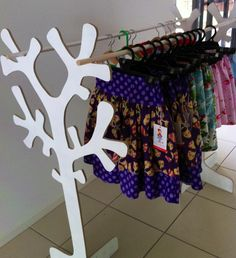 Wooden tree clothes rack- I would drill holes in the tree for the rods to slide through, making it more stable