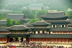 SOUTH KOREA:  Gyeongbokgung Palace was built in 1395, it is located in northern Seoul, South Korea. Gyeongbokgung is a wonderful study in continuity. The blue tiled roof in the back is the presidential mansion—even six centuries on, this spot is still Korea's seat of power.