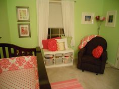 Cute pink and green nursery-- love the little storage window seat!