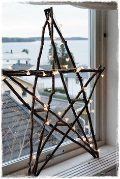 star constructed from twigs and strung with mini lights