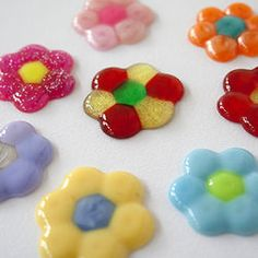 Rainbow colored flower magnets using transperent pony beads heated melted in…