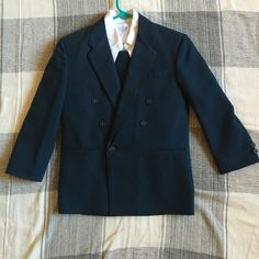 Deep Blue Boy's Suit I bought this suit for my son to wear to a wedding, and now it's just sitting in his closet. Brand new and a child's medium (kids' size 8). 3 pieces: shirt, pants and blazer. George Jackets & Coats Blazers