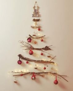 What a simply gorgeous DIY! A beautiful, inexpensive way to add holiday spirit to any blank wall with some branches, twinkle lights and… Diy Xmas, Easy Christmas Crafts, Simple Christmas, All Things Christmas, Driftwood Christmas Tree, Wall Christmas Tree, Gold Christmas, Zara Home Christmas, Sweden Christmas